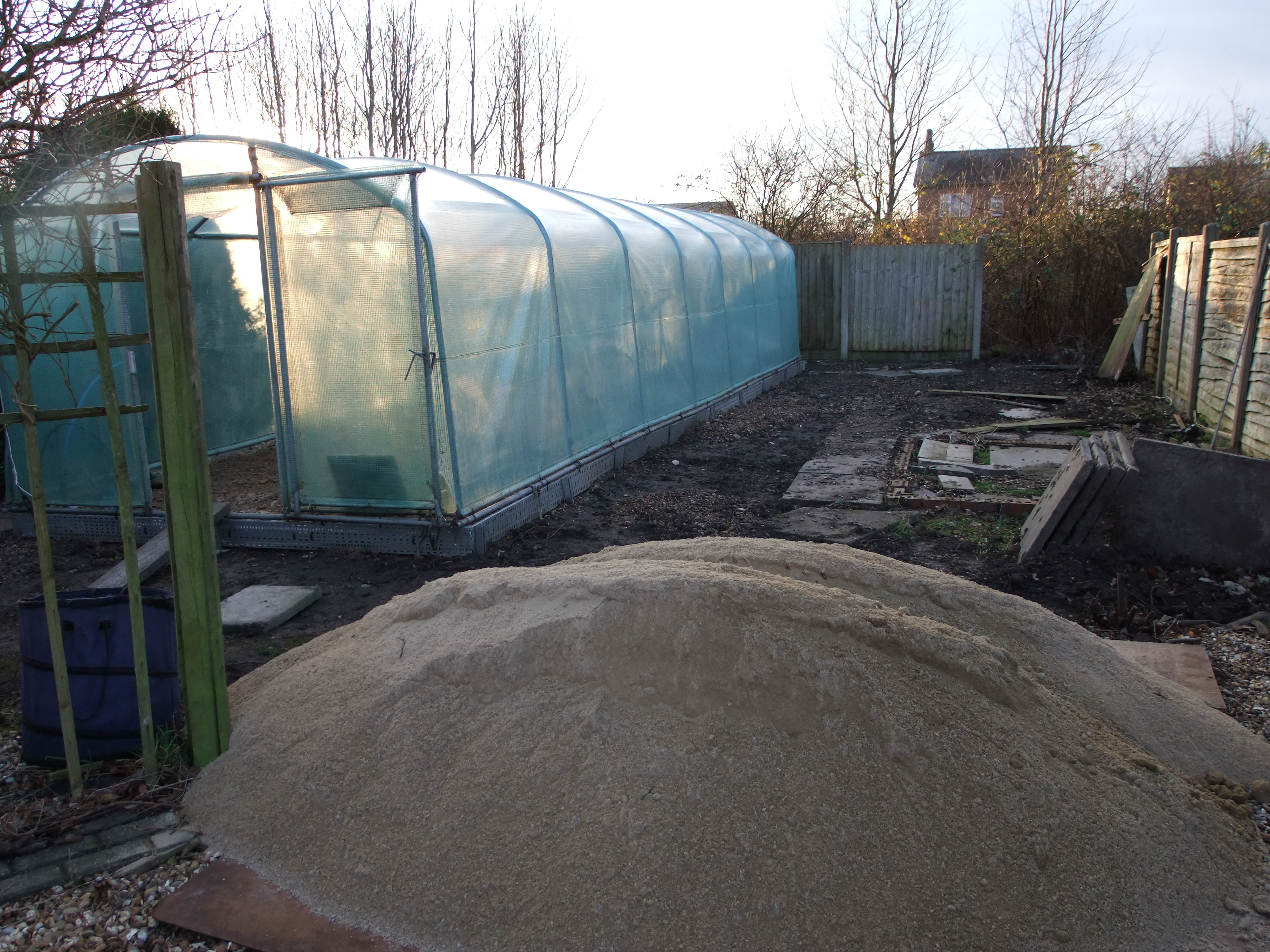 Siting the poly tunnel in the cleared orchard area